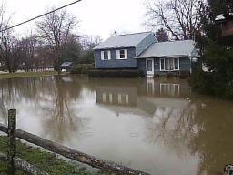 The flood approaches 145 Craig Lane