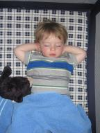 Sylvan sleeps with his hands behind his head