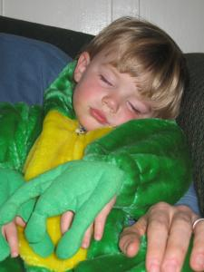 Sylvan fell asleep in a toasty frog costume in Dad's arms