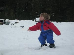 Sylvan throwing a snowball at Mom