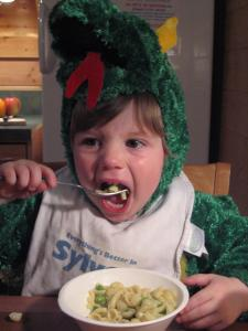 Two of Sylvan's favorite things: dragon costume and mac 'n' cheese