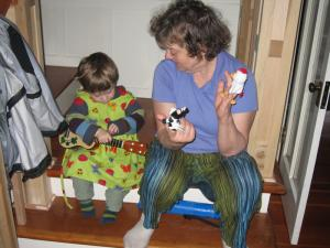 Sylvan and Gramma Mia, singing songs with puppets