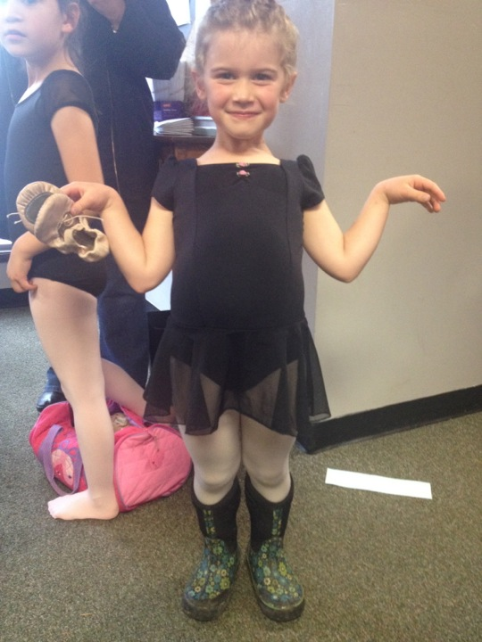 girl wearing ballet clothes and rain boots
